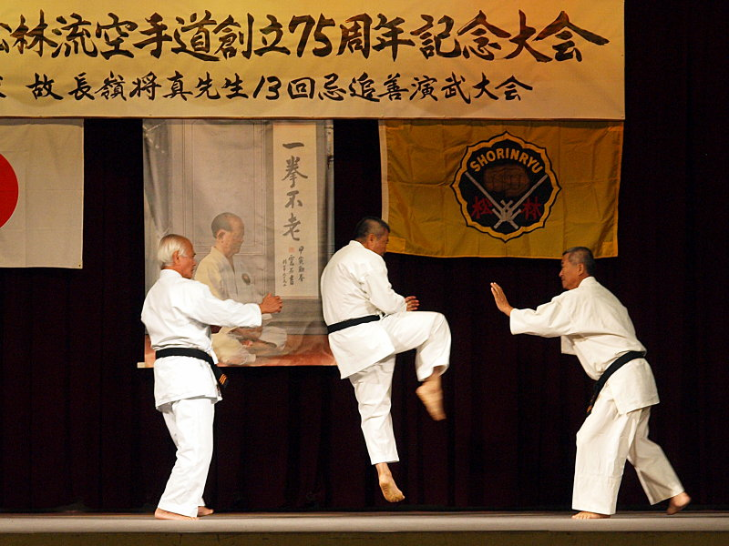 Senseis Taira, Arakaki and Higa demonstrating bunkai to Kusanku