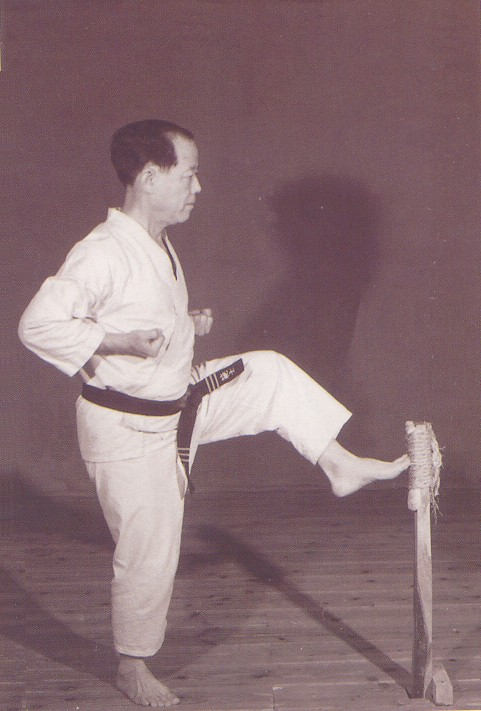 Osensei Nagamine practising kicks on makiwara